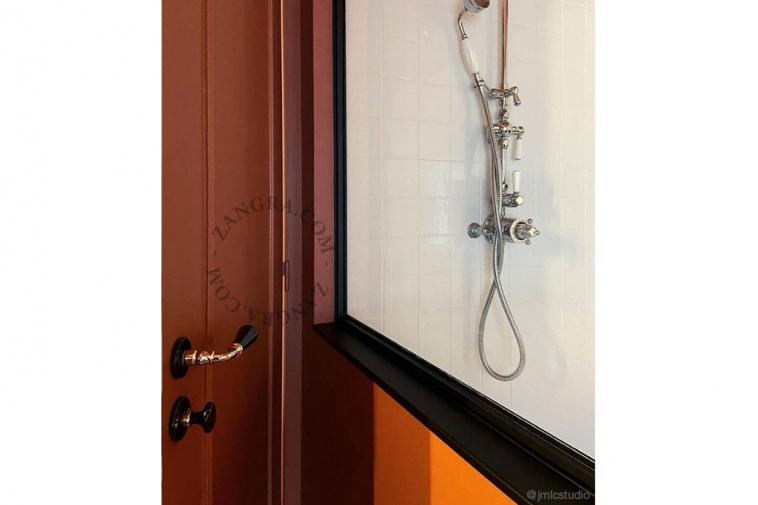 black-handle-porcelain-door-knob-brass