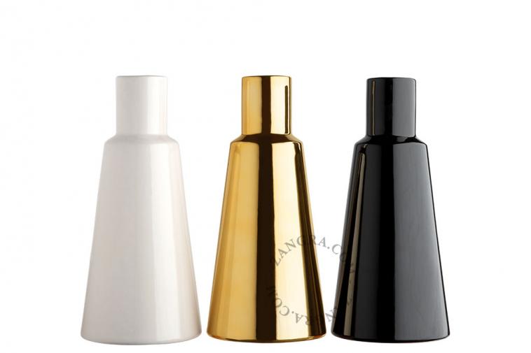 gold-vase-black-white-ceramic